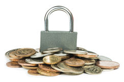 Grey locked padlock and coins Royalty Free Stock Images