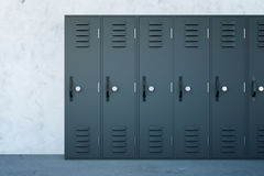 Grey lockers. Close up of grey lockers in school corridor with concrete walls and floor. 3D Rendering Royalty Free Stock Photography