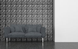 Grey Love Seat in front of Decorative Metal Screen Stock Image