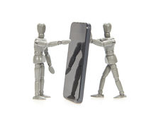 Grey mannequins holding smartphone Royalty Free Stock Photo