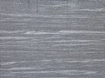 Grey marble with horizontal white marbling lines Royalty Free Stock Photo