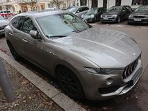 Grey Maserati car with trident logo. Berlin, Germany - December 8, 2017: Grey Maserati car with trident logo. The logo of the Italian luxury vehicle manufacturer Stock Photos