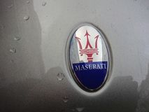 Grey Maserati car with trident logo. Berlin, Germany - December 8, 2017: Grey Maserati car with trident logo. The logo of the Italian luxury vehicle manufacturer Royalty Free Stock Photos
