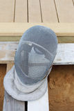 Grey Mask for fencing made of steel wire on wooden boards Royalty Free Stock Image