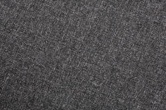 Grey material in abstract patterns, a background Stock Photos