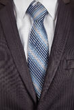 Grey men's business suit with a silk tie