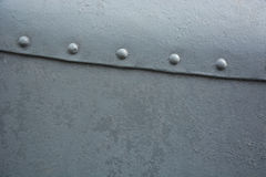 Grey metal background with rivets Royalty Free Stock Photography