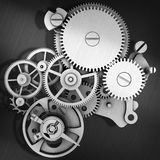 Grey metal cog gears joining together Stock Photos