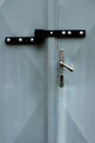 Grey metal gate double locked. Grey metal garage gate double locked with hasp Royalty Free Stock Photo