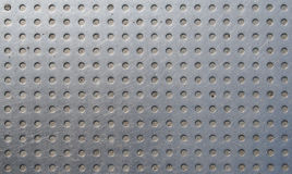 Grey metal grid. Metal grid with circle shapes Royalty Free Stock Photo