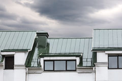 Grey metal roof with windows during the rain Royalty Free Stock Photography