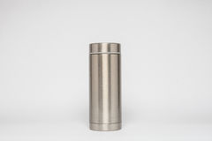 Grey metal water flask on a white background Stock Image
