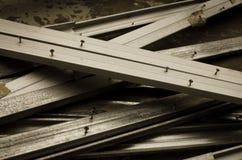 Grey metallic bar with nail Royalty Free Stock Image
