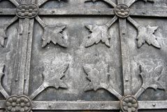 Grey metallic door of an old church. Abstract background. Stock Image