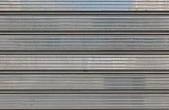 Grey metallic garage door for backgrounds, polish. royalty free stock photography