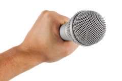 Grey microphone in hand Royalty Free Stock Images