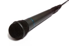 Grey microphone isolated on white. Professional karaoke microphone of darkly-grey color. Isolated on white Royalty Free Stock Image
