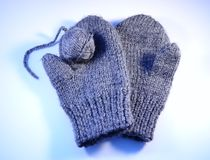 Grey  mittens Stock Images