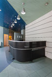 Grey modern counter. On an entrance to company Royalty Free Stock Image