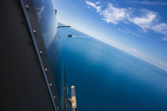 Grey modern warship, helicopter view Royalty Free Stock Images