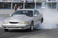 Drag racing. Napierville dragway july 12, 2014 picture of grey mustang drag car making burn out during nhra national open event Royalty Free Stock Images