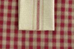 Grey napkin. On a checked tablecloth Royalty Free Stock Photos