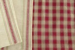 Grey napkin. Napkin on a checked tablecloth Royalty Free Stock Photography