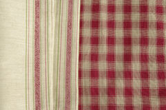 Grey napkin. Striped and checked red and grey tablecloth Royalty Free Stock Photo