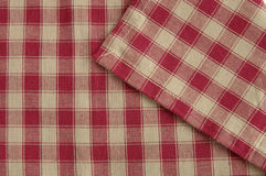 Grey napkin. Checked red and grey tablecloth, background Royalty Free Stock Photos