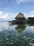 Grey Nipa Hut Near Sea during Daytime Royalty Free Stock Images