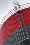 Grey oil storage tanks. Escape ladder on a oil storage tank Royalty Free Stock Image