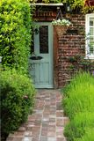 Grey Old Door With Orange Bricky Wall and Green Lavender Garden Stock Photos