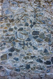 Grey old  stone wall background Stock Images