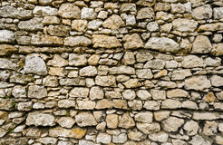 Grey old stonewall as background. Stock Image
