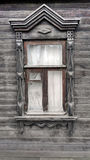 The grey old window. With a some ethnic motives Royalty Free Stock Images