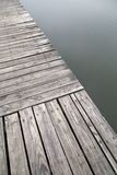 Grey old wood pier by the lake view Royalty Free Stock Photos