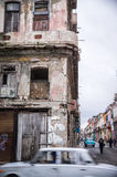 Grey oldtimer in front of aged facade in Havana, Cuba Royalty Free Stock Image
