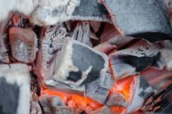 Grey Glowing Decaying Charcoals Closeup royalty free stock photo