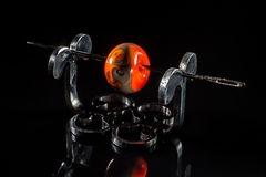 Grey and orange glassy bead on stand Stock Images