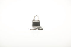 Grey padlock with key Stock Image