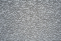 Grey painted pebble stones on a wall Royalty Free Stock Photo