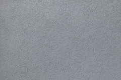 Grey painted stucco wall. Background texture Stock Photos