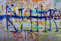Grey Painted Wall. Abstract multi-colored writing on the wall Royalty Free Stock Image