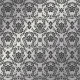 Grey patterns. Graceful decorative wallpaper of silvery tones Stock Photography