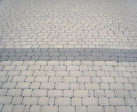 Grey pavement. With dark stripe royalty free stock photography