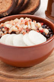 Grey peas with bacon and onion. Latvian food - boiled grey peas with bacon, onion and black bread Stock Photos