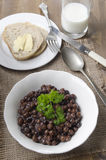Grey peas with parsley in a bowl Royalty Free Stock Photos