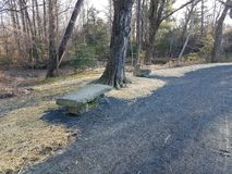 Grey pebble path with stone bench and straw royalty free stock photography