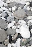 Grey pebbles and rocks in a beach Royalty Free Stock Photography