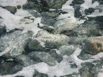 Grey pebbles at the seashore Stock Photography